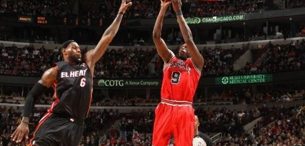 Luol Deng ante LeBron James / Getty Images